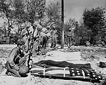 Marines mourn the loss of comrades on Saipan.