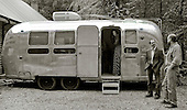 """An airstream trailer fitted out as a mobile sound recording engineer's mixing base .  Set up to record the """"Edge of Chaos Orchestra"""" playing inside the Blue Coconut Club, Pulborough, West Sussex."""