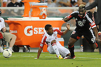 D.C. United defender Brandon McDonald (4) gets fouled by Toronto FC defender Ashtone Morgan (5) D.C. United defeated Toronto FC 3-1 at RFK Stadium, Saturday May 19, 2012.