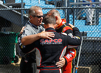 Jul 10, 2016; Joliet, IL, USA; NHRA chaplain Craig Garland (left) prays with top fuel driver Steve Torrence (center) and Doug Kalitta during the Route 66 Nationals at Route 66 Raceway. Mandatory Credit: Mark J. Rebilas-USA TODAY Sports