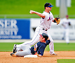 2 March 2010: New York Mets' infielder Russ Adams gets outfielder Matt Young out at second during a game against the Atlanta Braves during the Opening Day of Grapefruit League play at Tradition Field in Port St. Lucie, Florida. The Mets defeated the Braves 4-2 in Spring Training action. Mandatory Credit: Ed Wolfstein Photo