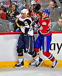 20 December 2008: Buffalo Sabres' center Adam Mair (22) is checked on the boards by Montreal Canadiens' right wing forward Matt D'Agostini (36) during the first period at the Bell Centre in Montreal, Quebec, Canada. With both teams coming off wins, the Canadiens extended their winning streak by defeating the Sabres 4-3 in overtime. ***** Editorial Sales Only ***** Mandatory Photo Credit: Ed Wolfstein Photo