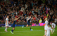 Manchester, England - Monday, August 6, 2012: The USA defeated Canada 4-3 in overtime in the semi-final round of the 2012 London Olympics at Old Trafford. Aex Morgan (13)  celebrates with Abby Wambach (14) after scoring the winning goal.