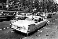 Bronx, New York City, NY - Summer of 1966 <br /> On Fox Street in the Bronx, an abandoned Plymouth &lsquo;Savoy&rsquo; becomes a jungle gym for kids to play in and on. <br /> Bronx, New York City, NY. Et&eacute; 1966.<br /> Les voitures abandonn&eacute;es deviennent la terrain de jeux des enfants en attendant que la fourri&egrave;re passe ramasser l&rsquo;&eacute;pave, ce qui peut prendre des semaines.