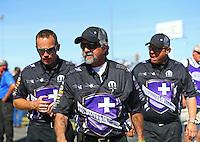 Apr 12, 2015; Las Vegas, NV, USA; NHRA funny car driver Jack Beckman (left) walks with his crew chiefs John Medlen (center) and Jimmy Prock during the Summitracing.com Nationals at The Strip at Las Vegas Motor Speedway. Mandatory Credit: Mark J. Rebilas-