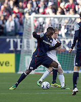 New England Revolution midfielder Shalrie Joseph (21) dribbles and DC United midfielder Dax McCarty (10) defends. In a Major League Soccer (MLS) match, the New England Revolution defeated DC United, 2-1, at Gillette Stadium on March 26, 2011.