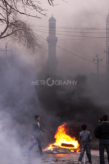 SULAIMANIYAH, IRAQ: A mosque is visible through the smoke of burning tires...A third day of violence rocks the Iraqi Kurdish city of Sulaimaniyah.  Tensions between protesters and security forces flare after the security forces continue to use life ammunition during the demonstrations...Photo by Ali Arcady