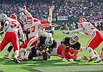 Oakland Raiders vs. Kansas City Chiefs at Oakland Alameda County Coliseum Sunday, November 5, 2000.  Raiders beat Chiefs  49-31.  Oakland Raiders full back Zack Crockett (32) dives for touchdown.