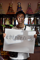 Yuen Fei - 27 Yrs.<br /> Post grad philosophy student and now owns small handicratf shop.<br /> Shanxi Province.<br /> <br /> 'I want China to be a bit democratic'.