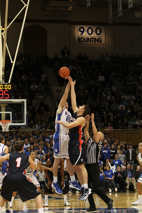 Miles Plumlee tips off for Duke. Duke beat Belmont 77-76 on Friday, November 11, 2011 at Cameron Indoor Stadium in Durham, NC. It was win number 901 for Duke head coach Mike Krzyzewski, making him only two wins away from the NCAA DivisionI all-time win record. Photo by Al Drago.