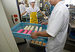 Staff load kamaboko and other products processed and packaged at the company's factory in Tome City, Miyagi Prefecture, Japan on 11 Sept. 2012.  Photographer: Robert Gilhooly