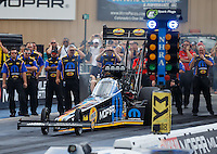 Jul 23, 2016; Morrison, CO, USA; Crew members with NHRA top fuel driver Leah Pritchett during qualifying for the Mile High Nationals at Bandimere Speedway. Mandatory Credit: Mark J. Rebilas-USA TODAY Sports