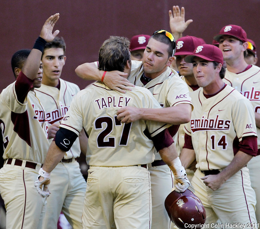 TALLAHASSEE, FL 10-FSU-TAMUBASE11 CH-Florida State's Stuart Tapley, is hugged by Robby Scott after Tapley scored a solo home run in the sixth inning against Texas A&M Sunday at Dick Howser Stadium during NCAA Super Regional action in Tallahassee. The Seminoles beat the Aggies 23-9 to stay alive in the best of three series...COLIN HACKLEY PHOTO