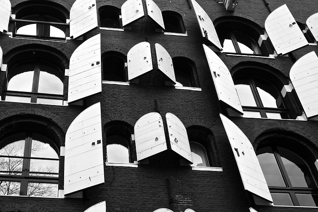 Windows and shutters are arranged in perfect symmetry on a building in Amsterdam, Netherlands. Feb. 28, 2009.