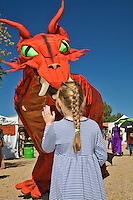 The Renaissance Fair is held each September at the historic museum of El Rancho de Las Golondrinas near Santa Fe and features dancers, kinghts, acrobats and many other performers all celebrating the culture and life style of the Medieval Middle Ages. A princess waves Hello to a Red Dragon.