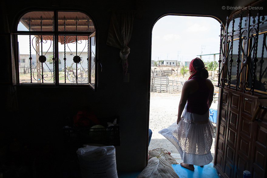 "Luz Betsaida Orozco Pineda stays at her home, during the 40-days quarantine period after giving birth, in Juchitán, Mexico on February 17, 2016. Now 14, Luz became pregnant when she was 13 after being ""stolen"" according to the Zapotec Indigenous tradition. Considered a traditional kind of marriage – Luz is too young to wed legally – the custom dictates that the couple go to the young man's house and announce their plans to marry. While the family waits, the couple go to a room together; he emerges later with a blood-stained handkerchief to prove his bride's virginity. Luz, who started going out with the father of her baby when she was 10, lives with her in-laws in the 6 de noviembre neighbourhood on the outskirts of Juchitán in the southern Mexican state of Oaxaca. Her baby was born on January 13, 2016. Despite following tradition, she speaks little Zapotec – the language of her husband and his family – she follows tradition, wearing a headscarf to protect her health as she is still observing the 40-days quarantine period after giving birth, during which she stays in the house. While Mexico has outlawed marriage under the age of 18, many young girls become unofficial wives and mothers much earlier. In Juchitán, teenage pregnancy is expected, even prized. Mexico ranks first in teenage pregnancies among the member countries of the Organization for Economic Co-operation and Development (OECD). Photo by Bénédicte Desrus"