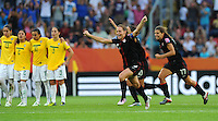 Christie Rampone (l) and Tobin Heath react at the penalty shootout during the FIFA Women's World Cup at the FIFA Stadium in Dresden, Germany on July 10th, 2011.