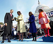 Washington, DC - January 20, 2009 -- United States President Barack Obama and his wife, Michelle, examine the bible used for his swearing-in ceremony at the U.S. Capitol in Washington, D.C., Tuesday, January 20, 2009. Daughters Malia, center right, and Sasha, right, look on..Credit: Chuck Kennedy - Pool via CNP