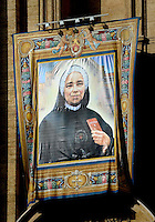 A tapestry depicting Italian Giulia Salzano hangs on the facade of Saint Peter's Basilica during a canonization mass in St. Peter's square, Vatican, 17 October 2010. The pope formally recognized Australia's first saint, Sister Mary MacKillop, who is revered as a pioneer of education in Outback Australia and the founder of the Sisters of St Joseph of the Sacred Heart. She was canonised along with Stanislaw Soltys of Poland, Andre Bessette of Canada, Candida Maria de Jesus Cipitria y Barriola of Spain, and Italians Giulia Salzano and Battista da Varano