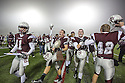 Cameron Yoe players celebrate after defeating White Oak in the Class 2A, Division I semifinal at Eagle Stadium in Allen on Friday, Dec. 13, 2013.
