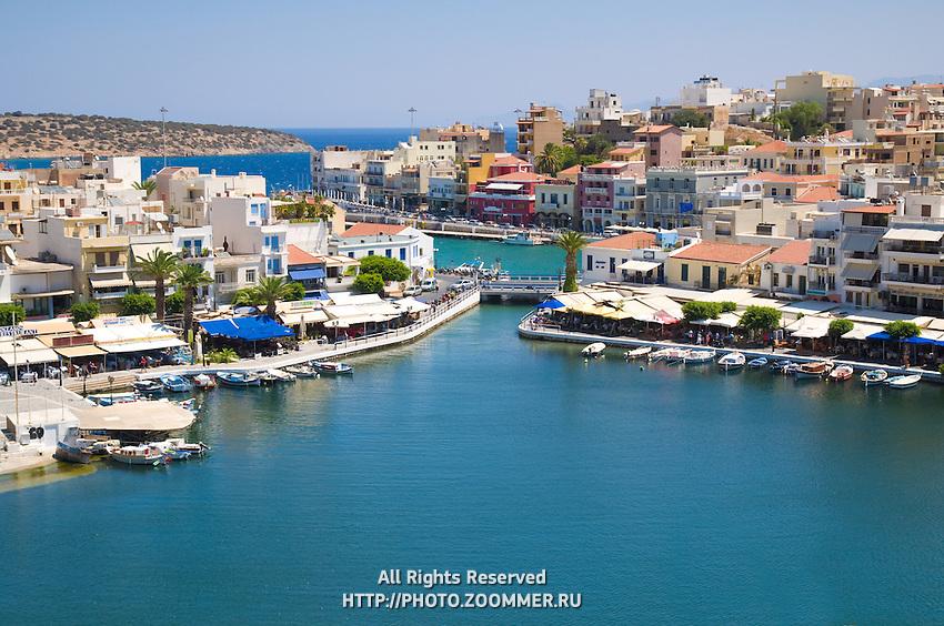 Lake Voulismeni with restaurants and boats in Agios Nikolaos, Crete