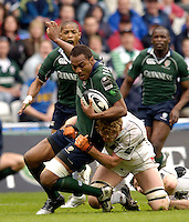 Reading, ENGLAND, Exiles, Sailosi Tagocakibau, is hauled to the ground by Sarries Hugh Vyvyan, during the London Irish vs Saracens, Guinness Premiership Rugby, at the, Madejski Stadium, 06.05.2006, © Peter Spurrier/Intersport-images.com,  / Mobile +44 [0] 7973 819 551 / email images@intersport-images.com.