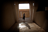 After several rounds of stadium to warm up, Mohamed, 12 years, hurries to join the boxing room for a daily training of 2:30.