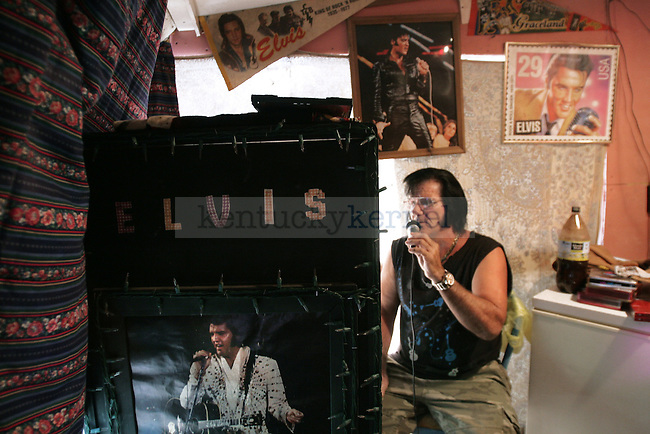 """Charles Hobbs performs his favorite Elvis song, """"But Love Me,"""" in his """"Elvis room."""" Over the years he has accumulated more than 50 Elvis CDs. """"I don't do this for the attention ... I do it because he was a great man. I liked him before he died, and I'll like him until the day I die myself."""" Photo by Matt Murray"""