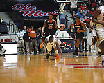 "Ole Miss' Terry Brutus (25) vs. Auburn forward Jordan Granger (25) at the C.M. ""Tad"" Smith Coliseum on Saturday, February 23, 2013.  (AP Photo/Oxford Eagle, Bruce Newman)"