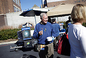 Dan Hill passes out samples of Joe's Dinner hot dogs at  Wallace Wade Stadium during a Duke football game Durham, N.C., Nov.  13, 2010. .
