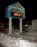 Snow and ice coat the Rehoboth Convention Center marquee in the center of Rehoboth Avenue at night, just after the end of the blizzard of February 2010.  (Rehoboth Beach, Delaware, USA)