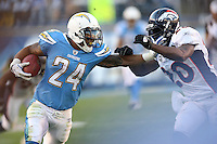 11/27/11 San Diego, CA: San Diego Chargers running back Ryan Mathews #24 and Denver Broncos strong safety Brian Dawkins #20 during an NFL game played between the Denver Broncos and the San Diego Chargers at Qualcomm Stadium. The Broncos defeated the Chargers 16-13 in OT