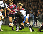 Jamie Robinson tackles Andrew Higgins. Cardiff Blues V Bath, EDF Energy Cup. &copy; Ian Cook IJC Photography iancook@ijcphotography.co.uk www.ijcphotography.co.uk