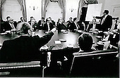 United States President Gerald R. Ford makes a point to Congressional leaders as United States Secretary of State Henry Kissinger points to a map of Cambodia during a White House briefing on the Mayaguez situation in Washington, D.C. on May 15, 1975.  United States Secretary of Defense James Schlesinger sits in front of the map. Sitting to President Ford's right, with his back to the camera, is Speaker of the House Carl Albert (Democrat of Oklahoma).<br /> Mandatory Credit: David Hume Kennerly / White House via CNP