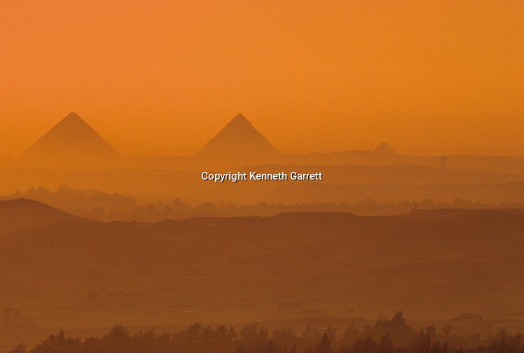 Egypt of the Pharaohs, Pyramids of Giza in the evening haze