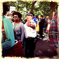 A New York Police Officer argues with demonstrators to leave the street while they take part in a march protesting against the Stop-and-Frisk polices in New York  Photo by Eduardo Munoz Alvarez / VIEW..PICTURE TAKEN WITH A MOBILE DEVICE.