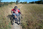 Peter Makura navigates along a path near his home in the village of Berejena, near Masvingo, Zimbabwe. Makura uses a wheelchair provided by the Jairos Jiri Association with support from CBM-US.
