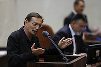 Left-wing 'Hadash' parliament member Dov Khenin during a vote on the so-called governability law. The governance law would raise the electoral threshold from 2 percent to 4 percent. Photo by Oren Nahshon
