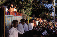 © Nic Dunlop / Panos Pictures..Rangoon, BURMA...Daw Aung San Suu Kyi addressing a crowd outside her home.