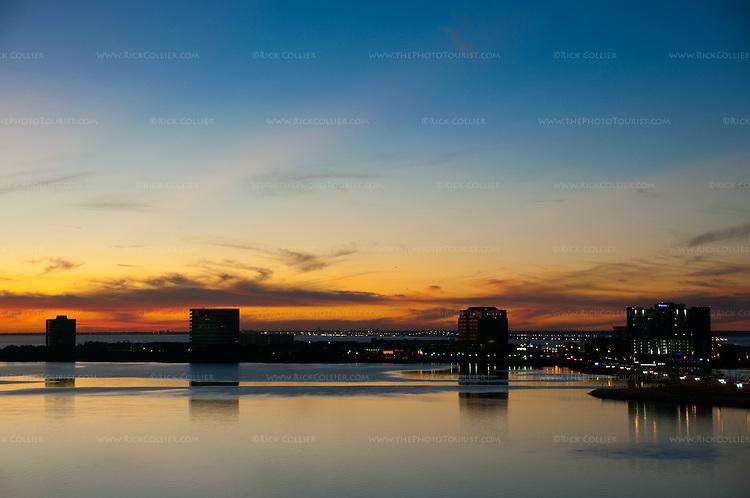 A golden sunset illuminates Tampa Bay.  Tampa, Florida, USA.