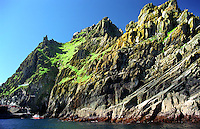Sunny day at Skellig Michael with boat lands at the island. Tourist start their walk hill upwards, The Great skellig islands, County Kerry, Ireland / sk004 I love the Skelligs,