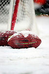 3 January 2010: NFL Footballs lie on a snowy turf on a cold, snowy, final game of the season between the Buffalo Bills and the Indianapolis Colts at Ralph Wilson Stadium in Orchard Park, New York. The Bills defeated the Colts 30-7. Mandatory Credit: Ed Wolfstein Photo