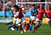 Hale T Pole of Tonga fends Chrysander Botha of Namibia. Rugby World Cup Pool C match between Tonga and Namibia on September 29, 2015 at Sandy Park in Exeter, England. Photo by: Patrick Khachfe / Onside Images