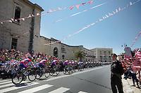 2013 Giro d'Italia.stage 6: Mola di Bari - Margherita di Savoia .169 km..Team Lampre-Merida riding through a typical pink welcome into town