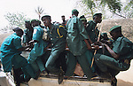 Hispah Sharia Police, a volunteer religious militia force, enforcing Sharia law...The implementation of Islamic Sharia Law across the twelve northern states of Nigeria, centres upon Kano, the largest Muslim Husa city, under the feudal, political and economic rule of the Emir of Kano. Islamic Sharia Law is enforced by official state apparatus including military and police, Islamic schools and education, plus various volunteer Militia groups supported financially and politically by the Emir and other business and political bodies. Fanatical Islamic Sharia religious traditions  are enforced by the Hispah Sharia police. Deliquancy is controlled by the Vigilantes volunteer Militia. Activities such as Animist Pagan Voodoo ceremonies, playing music, drinking and gambling, normally outlawed under Sharia law exist as many parts of the rural and urban areas are controlled by local Mafia, ghetto gangs and rural hunters. The fight for control is never ending between the Emir, government forces, the Mafia and independent militias and gangs. This is fueled by rising petrol costs, and that 70% of the population live below the poverty line. Kano, Kano State, Northern Nigeria, Africa