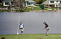 (L-R) Hiroyuki Kato, Ryo Ishikawa (JPN),.MARCH 23, 2012 - Golf :.Ryo Ishikawa of Japan puuts on the green of 6th hole as his caddie looks on during the second round of the Arnold Palmer Invitational at Arnold Palmer's Bay Hill Club and Lodge in Orlando, Florida. (Photo by Thomas Anderson/AFLO)(JAPANESE NEWSPAPER OUT)