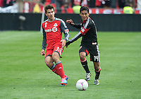 06 October 2012: Toronto FC Andrew Wiedeman #32 and D.C. United midfielder Andy Najar #14 in action during an MLS game between D.C. United and Toronto FC at BMO Field in Toronto, Ontario..D.C. United won 1-0..
