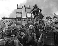 As against &quot;The Shores of Tripoli&quot; in the Marine Hymn, Leathernecks use scaling ladders to storm ashore at Inchon in amphibious invasion September 15, 1950.  The attack was so swift that casualties were surprisingly low.  S.Sgt. W.W. Frank. (Marine Corps)<br /> NARA FILE #:  127-N-A3191<br /> WAR &amp; CONFLICT BOOK #:  1419