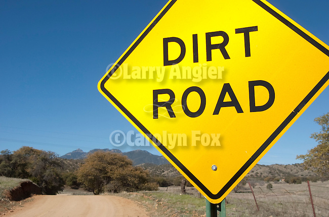 Sign stating the obvious: Dirt Road along a dirt road in rural Arizona