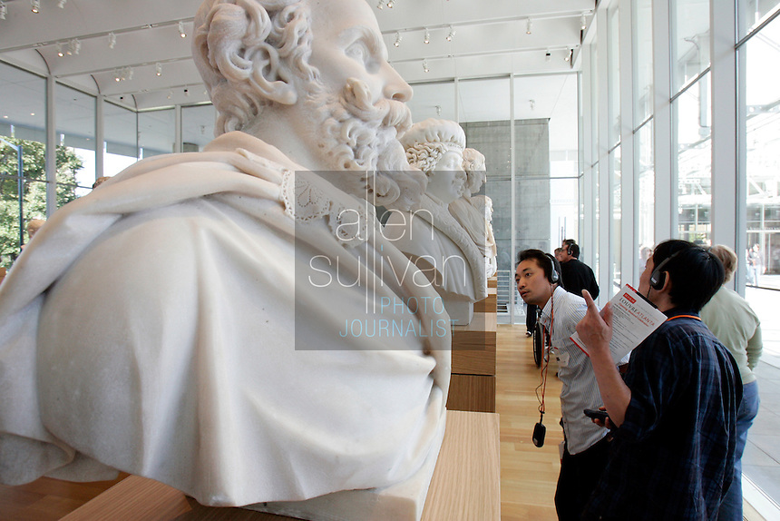 Patrons view sculptures during the pubic opening of Louvre Atlanta at the High Museum of Art. Over the next three years, the High Museum will feature hundreds of works of art from the Musée du Louvre in Paris.